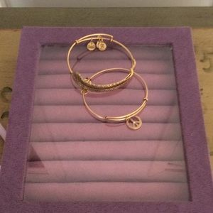 Two gold tone Alex and Ani bracelets